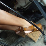 Barbie Cranking & Revving the Bus in Brown Wedges
