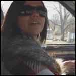 Damara Cruising in the Caddy in Stiletto Pumps, 2 of 2