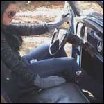 Mandie Revving the Bug in Stiletto Pumps