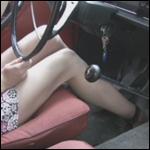 Kristen Revving Volvo in Ankle Strap Heels, 2 of 2
