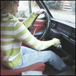 Reese Barefoot Pedal Pumping the Volvo, 2 of 3