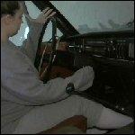 Jeanell Cranking Volvo in Sweatsuit & Socks