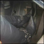 Marilyn Battles the Volvo in OTK Boots & Gloves, 2 of 7