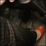 Milla Cranking the Volvo in Peep Toe Pumps, 1 of 2