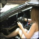 Nikki Getting the Old Vette Started