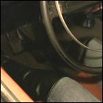 Roxy Cranking the Volvo in the Garage in OTK Boots
