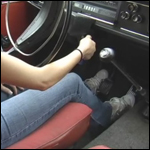 Roxy Cranking the Volvo in Old Sneakers