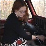 Scarlet Cranking Bronco in Pantyhose & High Heels, 1 of 2
