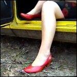 Scarlet Cranking Porsche in Red Pumps, 1 of 3