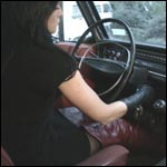 Asia Cranks & Tries Moving the Volvo in Thigh High Boots