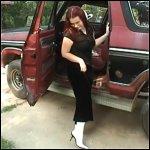 Scarlet Cranks & Revs the Bronco in White Boots