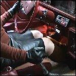 Scarlet Stuck in the Mud in the Oldsmobile