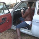 Sasha Cranking the Volvo in Leather Jacket & Boots