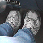 Scarlet Driving the Monte in Sneakers (footwell only)