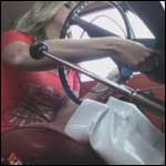 Stacey Cranks the Volvo in Bare Legs & Thigh High Boots, 2 of 3