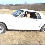 Stormy Driving her Mustang in the Field