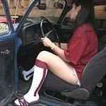 Hana Cranks the Bug with Collegiate Pride in Adidas Sandals