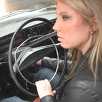 Barbie Struggles with the Volvo in Leather Boots