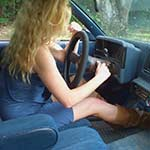 Britney Cranking the Monte Carlo in Blue Dress & Tan Boots, 1 of 2