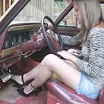 Elizabeth Cranking Up the Jeep in Black Patent Stiletto Pumps