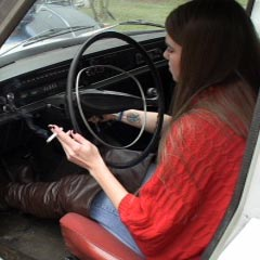 Kristen Trying to Start the Volvo in Boots & Smoking