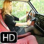 Cassandra Revving the Volvo in Open Toe Sandals
