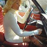 RockettGirl Cranking the Volvo in Sweater Dress & Boots