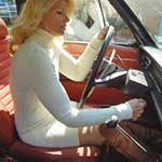RockettGirl_crank_1970volvo_whitesweaterdressboots-pic