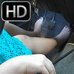 Scarlet Cranks & Drives Volvo in Pumps & Bare Feet