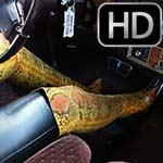 Cassandra Revving the Coupe DeVille in Snakeskin Boots