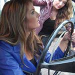 Mandie & Tinsley Crank & Rev the Volvo in Boots & Leather