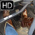 Laney Torino Revving the Bug in Shiny Cowgirl Boots