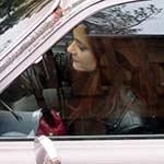 Vivian Crank & Drive Coronet in Red Driving Gloves & Reeboks, 1 of 2