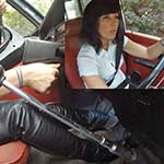 Hana Cranks & Revs the Volvo in Leather Pants & Boots, 1 of 2