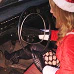 Cassandra Gassing Up the Sleigh in Thigh High Boots