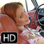Vivian Ireene Pierce Gives a Leg Tease Revving the Volvo, 1 of 4