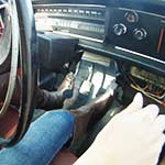 Tinsley Driving the Volvo Brown Boots Over Jeans
