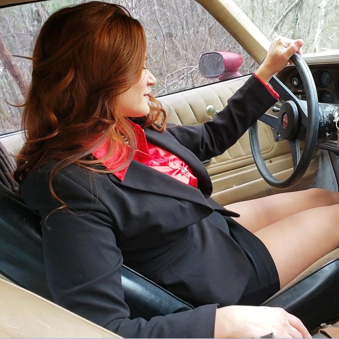 Vivian Hard Revving the '77 Z28 in Business Suit, Sheer Hose & Shiny Pumps