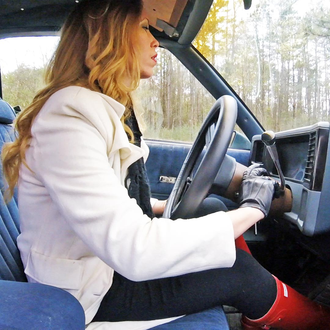 Cassandra Cold Starts the Monte Carlo in Leather Gloves & Red Hunter Boots