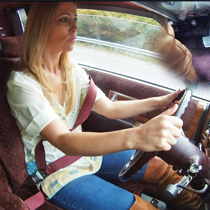 Cassandra Driving the Caddy to DMV in Tan OTK Boots, 1 of 2