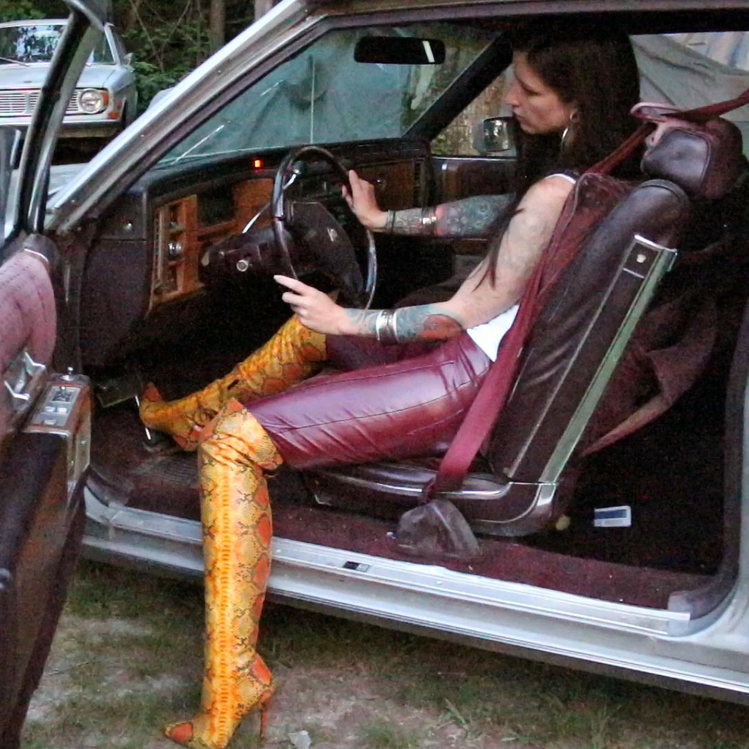 Sylvia Cranks & Revs the Cadillac in Red Leather Pants & Yellow Snake Print Boots
